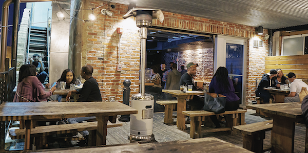 The upper decks at Smith Commons provide an intimate space to dine and drink on H Street NE. (Photo by Forrest Givens)