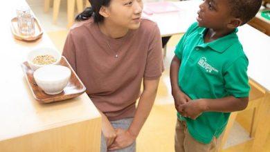 Xueli Zheng chats with one of her students at Lee Montessori School in the Anacostia neighborhood. (Courtesy of Lee Montessori School)