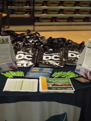 DC's Department of Insurance, Securities, and Banking partnered with H.D. Woodson High School to introduce financial literacy to 11th and 12th grade students. They passed out Bank on DC bags and pens to students. (Shantella Y. Sherman/The Washington Informer)