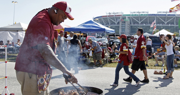 Fans cooking up something good during a tailgate party at FedEx Field before a Redskins game (Courtesy of American Eagle Limo)