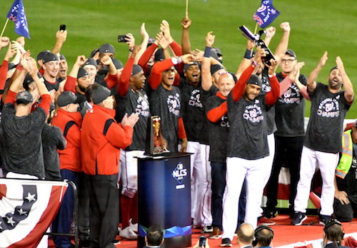 Washington Nationals manager Dave Martinez raises the trophy and celebrates with his team after sweeping the St. Louis Cardinals in the National League Championship Series at Nationals Park in southeast D.C. on Oct. 15. (John E. De Freitas/The Washington Informer)