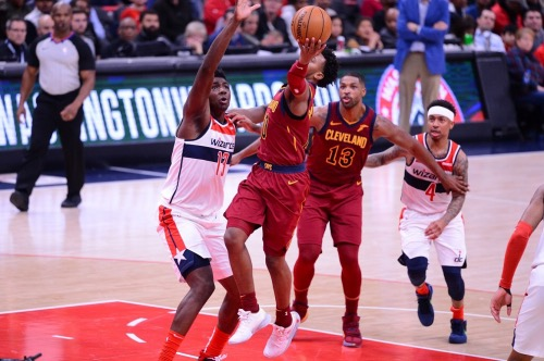 Cleveland Cavaliers guard Darius Garland attempts a layup over Washington Wizards center Thomas Bryant during Cleveland's 113-100 victory at Capital One Arena in D.C. on Nov. 8. (John E. De Freitas/The Washington Informer)