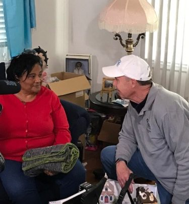 Washington Gas President/CEO Adrian Chapman gives safety goodies to District Heights, Md., homeowner Desiree Parker during the company's annual Day of Weatherization program on Nov. 9. (Courtesy of Washington Gas)