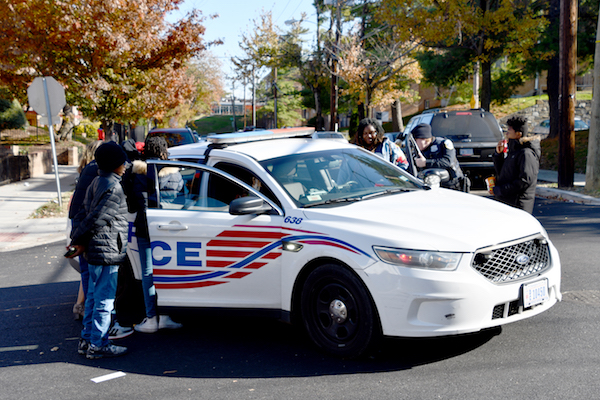 A police car was present at a block party and rally on Nov. 16 hosted by the TraRon Center, a community provider of therapy for gun violence trauma, on the campus of DC Prep Benning Middle School in Northeast. (Anthony Tilghman/The Washington Informer)