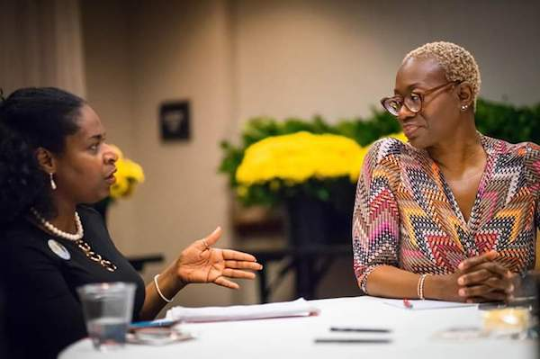 Terri L. Crawford (left) interviews former Ohio state Sen. Nina Turner. (Abiola Kosoko/DemoLives.com)