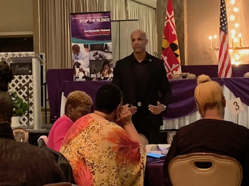 Michael A. Jones explains to the audience why they need to be alert about their surroundings during a safety, security and awareness presentation at the Sacred Spaces Interfaith Symposium at Martin's Crosswinds in Greenbelt, Md., on Oct. 26.