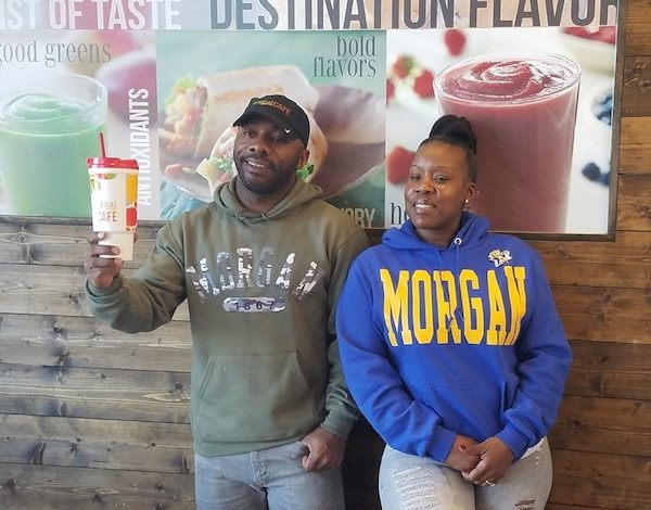 David Magby (left) and Alesha Hicks pose for a photo Nov. 11 at the Tropical Smoothie Café in Temple Hills, which they established last year. The couple aims to open a second café. (William J. Ford/The Washington Informer)