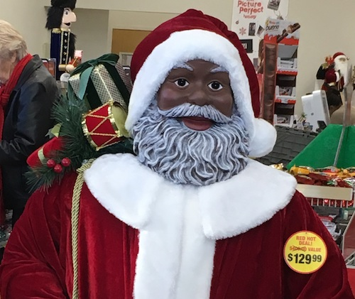 This Black Santa seen in CVS stores across the country is one way that corporations appear to try harder to reach African-Americans and other consumers of color. But levels of active advertising with Black media that reach Black consumers remains disappointing. (Courtesy of Trice Edney News Wire)