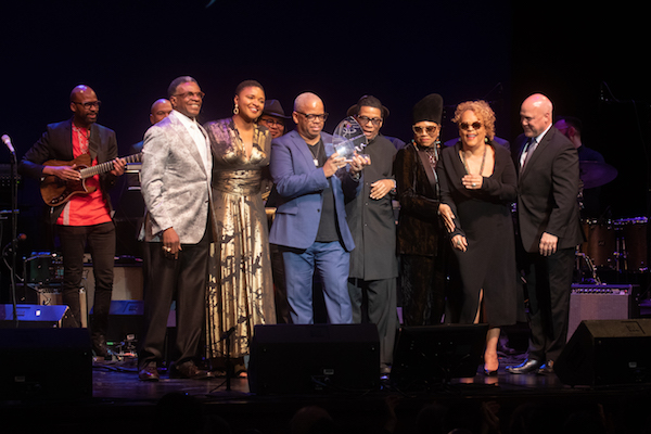 Trumpeter Terence Blanchard (center) receives the 2019 Maria Fisher Founder's Award from Herbie Hancock during the Herbie Hancock Institute of Jazz International Competition finals on Dec. 2. Also onstage is (from left) guitarist Lionel Loueke, actor Keith David, vocalist Lizz Wright, NEA jazz master Dee Dee Bridgewater, jazz vocalist Cassandra Wilson and former New Orleans Mayor Mitch Landrieu. (Shevry Lassiter/The Washington Informer)
