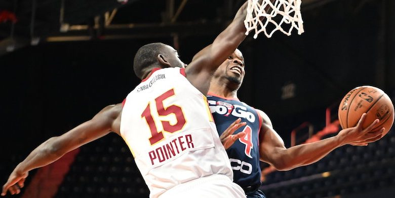 Capital City Go-Go guard Ike Iroegbu attempts a layup against Canton Charge forward Sir'Dominic Pointer during the Go-Go's 113-108 win at the Entertainment and Sports Arena in southeast D.C. on Dec. 7. (John E. De Freitas/The Washington Informer)