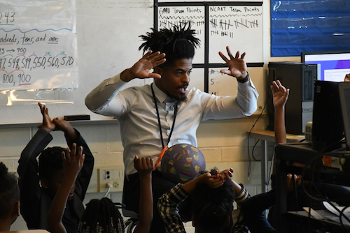 Eugene Banks, a second-grade math and science teacher at Ketcham Elementary School in Southeast, infuses call-and-response, movement and words of wisdom in his instruction. (Roy Lewis/The Washington Informer)