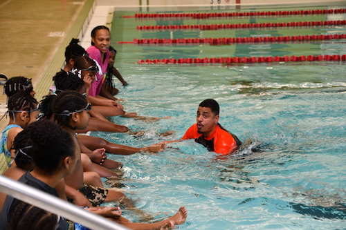 Elementary school students from Aiton Elementary School receive swimming instructions from Cosme Lantigua. (Anthony Tilghman/The Washington Informer)