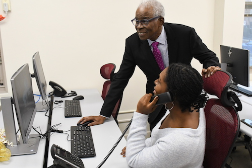 Professor Gary Lynn Harris and graduate student Dana McCalla use Howard University's new Graduate School Research and Media Center after a ribbon-cutting ceremony held on its campus Dec. 9. (Roy Lewis/The Washington Informer)