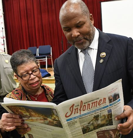 David Marion, 41st grand basileus of the Omega Psi Phi Fraternity, Inc., and Bettye Gardner, executive council for ASALH, read The Washington Informer. (Roy Lewis/The Washington Informer)