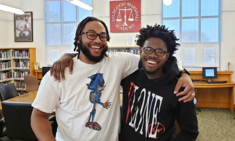 hurgood Marshall Academy mentor Shelton, who works with student Barry, is among the volunteers at the heart of work at the Southeast school. (TMA photo)