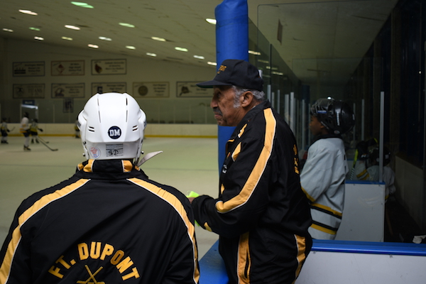 Neal Henderson, a lifelong hockey player and recent U.S. Hockey Hall of Fame inductee, coaches young ice skaters at the Fort Dupont Ice Hockey Club in southeast D.C. (Anthony Tilghman/The Washington Informer)
