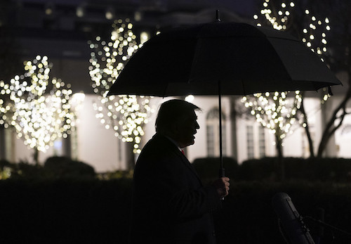 President Trump is seen in silhouette holding an umbrella as he talks to members of the press on the South Lawn of the White House on Dec. 10, 2019. (Joyce N. Boghosian/The White House)