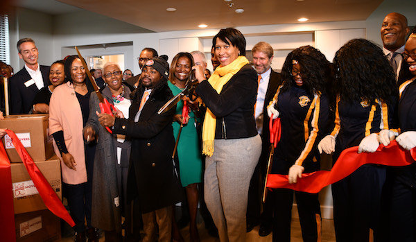 D.C. Mayor Muriel Bowser cuts the ribbon for the Residences at St. Elizabeths East in the Congress Heights neighborhood of Ward 8 on Nov. 23. (Anthony Tilghman/The Washington Informer)