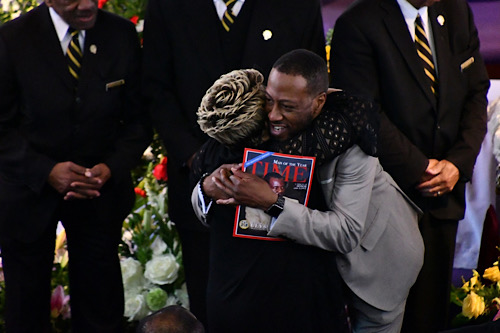 The Rev. Tony Lee (right) hugs the Rev. Shirley Gravely-Currie during a funeral service for her husband, Sen. Ulysses Currie, at Allen Chapel AME Church in southeast D.C. on Jan. 11. (Anthony Tilghman/The Washington Informer)