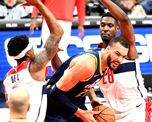 Utah Jazz center Rudy Gobert is double-teamed by Washington Wizards center Ian Mahinmi (28) and guard Bradley Beal in the first half of Utah's 127-116 win at Capital One Arena in D.C. on Jan. 12. (John De Freitas/The Washington Informer)