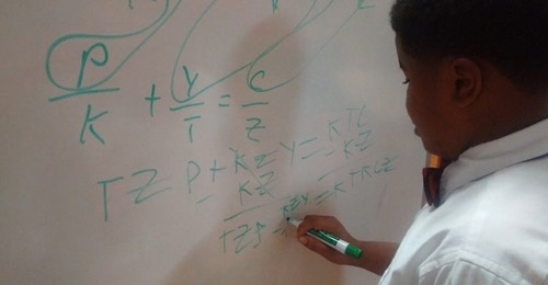 T.M Landry 5th grader D'Myrie Clay completes algebra problem for high school peers. (Courtesy of The Drum via NNPA Newswire)