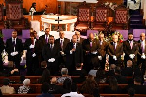 Members of Omega Psi Phi fraternity honor the late Sen. Ulysses Currie, a member of the organization's Gamma Pi chapter, during a memorial service for Currie at Allen Chapel AME Church in southeast D.C. on Jan. 11. (Anthony Tilghman/The Washington Informer)