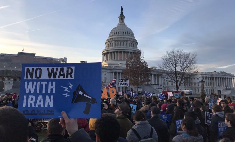 Demonstrators gather in front of the U.S. Capitol to protest the action of the United States that might potentially send troops to war. (Anthony Tilghman/The Washington Informer)