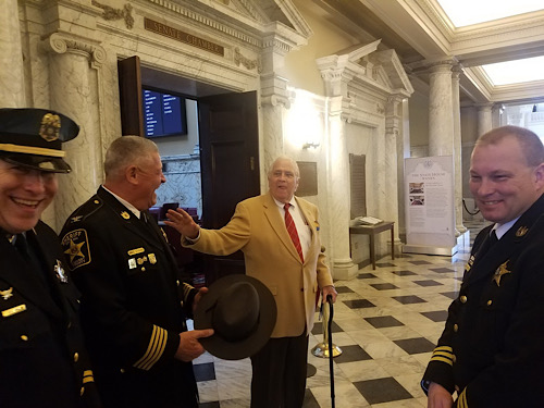 Sen. Thomas V. Mike Miller Jr. (center) greets law enforcement personnel visiting the State House in Annapolis on Jan. 9 in honor of National Law Enforcement Appreciation Day. (William J. Ford/The Washington Informer)