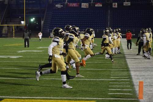 The Potomac High School football team warms up Dec. 7 before Maryland 2A state championship game in Annapolis. (Courtesy of Potomac High School)