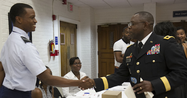 **FILE** Maj. Gen. Phillip M. Churn, the commanding general for the 200th Military Police Command, shakes the hand of Air Force ROTC cadet during the Student Leadership Conference at the Howard University School of Law in Washington, Aug. 29, 2015. The conference focused on challenging graduate and undergraduate students to become leaders and change agents in society, Maj. Gen. Churn delivered the closing address at the ceremony. (usar.army.mil)