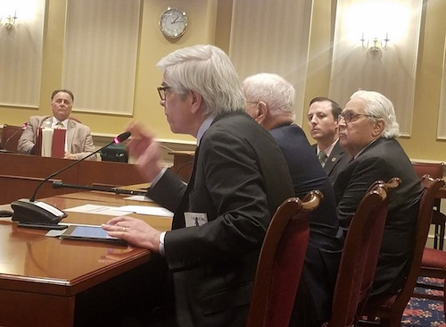 Paul Romer (foreground) testifies in support of proposed legislation to tax digital advertising to help fund restructuring Maryland's public school system on Jan. 29. At the table with Romer is (from left) his father, former Colorado Gov. Roy Romer, state Sen. Thomas V. Mike Miller Jr. and state Senate President Bill Ferguson. (William J. Ford/The Washington Informer)