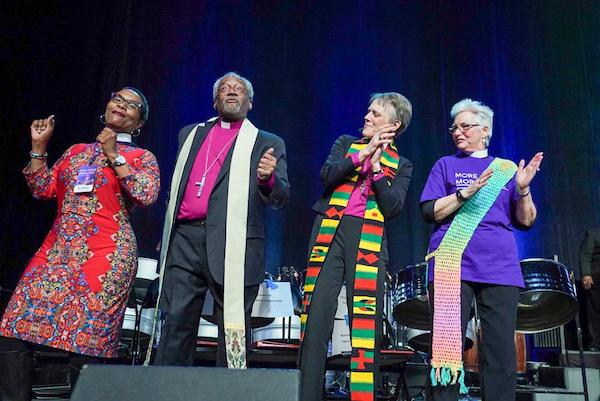 "Rev. Michael B. Curry (second from left), bishop of the Episcopal Church, dances with leaders of the Episcopal Diocese of Washington during the ""More Jesus, More Love"" revival at the Entertainment and Sports Arena in D.C. on Jan. 26. (Jay Mallin/Episcopal Diocese of Washington)"