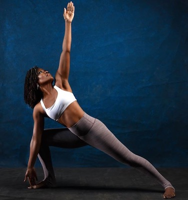 Kendra Dibinga Blackett, owner of the BikramYogaWorks studio in Northeast, in a yoga pose (Courtesy of Drew Xeron)