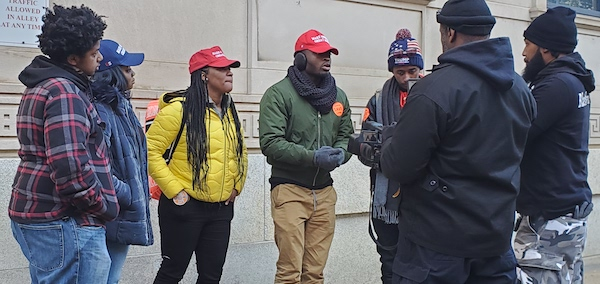 """A group of young Black Trump supporters wearing hats bearing his """"Make America Great Again"""" campaign slogan attend a gun control rally at the Virginia state capitol in Richmond on Jan. 20. (Dorothy Rowley/The Washington Informer)"""