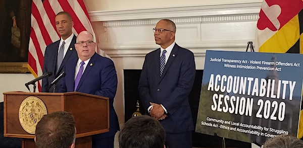 Maryland Gov. Larry Hogan (center) holds a Jan. 7 press conference in Annapolis to introduce proposed legislation focused on accountability. Lt. Gov. Boyd Rutherford (right) and Keiffer Mitchell Jr., Hogan's chief legislative officer, stand alongside the governor. (William J. Ford/The Washington Informer)