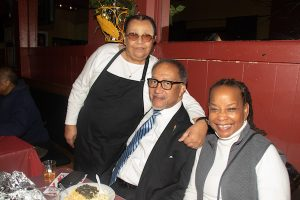 Georgene Thompson (left), with Dr. Benjamin Chavis, president of the National Newspaper Publishers Association, and Denise Rolark Barnes, publisher of The Washington Informer, during a photo-op at Georgene's Restaurant in Southeast, which hosted members of the MLK Parade committee for a luncheon after the event on Jan. 20. (Shevry Lassiter/The Washington Informer)