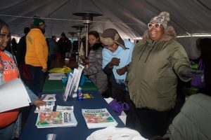 The U.S. Census Bureau volunteers set up a table at the MLK Health Fair to share information on the 2020 Census. The health fair was held simultaneously with the Parade and provided attendees with the opportunity to receive coats, food and health education. (Shevry Lassiter/The Washington Informer)