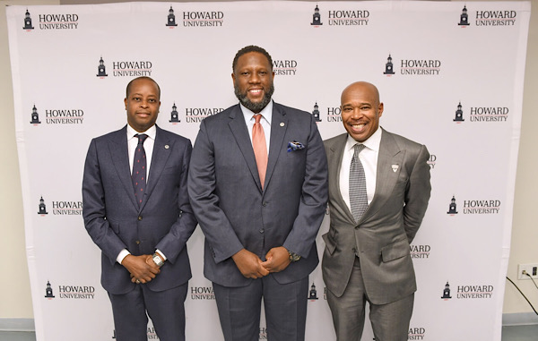 Larry Scott (center) is introduced as Howard University's new head football coach by HU President Wayne A.I. Frederick (left) and Director of Athletics Kery Davis during a Feb. 6 press conference at the school's northwest D.C. campus. (Courtesy of Howard University)