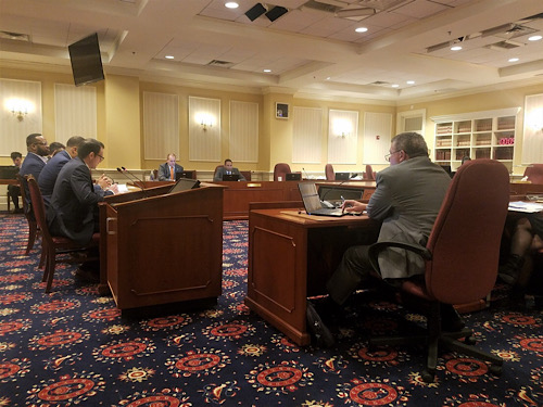 Maryland state Sen. Justin Ready (left in foreground) presents proposed legislation in Annapolis on Feb. 12 to improve safety in college sports and compensation for athletes. (William J. Ford/The Washington Informer)