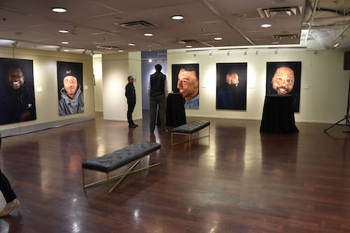"""Life Beyond the Line,"" an exhibit on display at the Pepco Edison Place Gallery, features local D.C. artists and highlights the first graduates from DC Infrastructure Academy (DCIA) in larger-than-life portraits captured by Reginald Cunningham. (Robert R. Roberts/The Washington Informer)"
