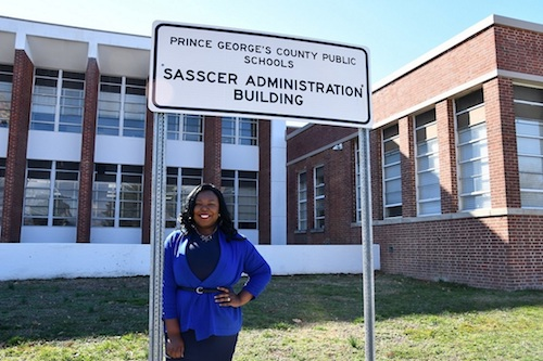 Krystal Oriadha stands outside the Sasscer Administration Building, the headquarters of Prince George's County Public Schools. Her organization, LGBTQ Dignity Project, wants the school system to train staff to help address the needs of LGBTQ students. (Anthony Tilghman/The Washington Informer)
