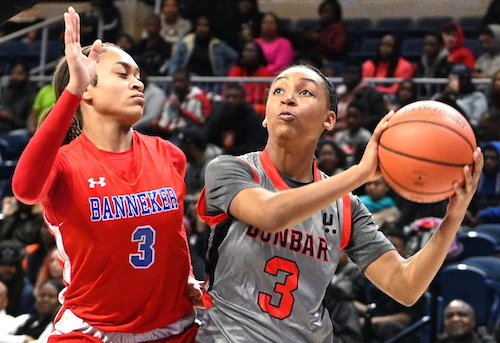 Dunbar guard Zy'aire Hairston looks to shoot over Banneker forward Naki Cobb during Dunbar's 63-35 win in the 2020 DCIAA championship game at the Entertainment and Sports Arena in southeast D.C. on Feb. 16. (John E. De Freitas/The Washington Informer)