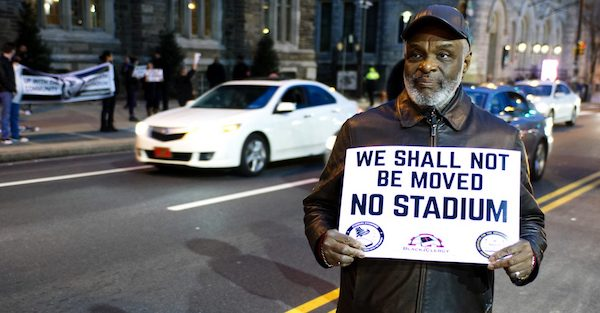 **FILE** Community members, activists and students protest the then proposed $130 million, 30,000-seat stadium on Temple University's campus in north Philadelphia. (iStockphoto via NNPA Newswire)