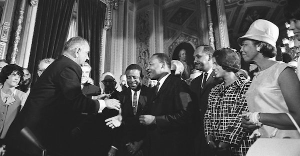 President Lyndon B. Johnson meets with Martin Luther King Jr. at the signing of the Voting Rights Act of 1965 on Aug. 6, 1965. (Lyndon Baines Johnson Library and Museum via Wikimedia Commons)