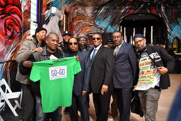 From left: Go-go legends E (Optimystic Tribe/Lissen), Sugar Bear (EU), Bubba (Backyard Band), James Funk (RE and Proper Utensils) and Buggie (Backyard Band) attend the ceremonial signing of a bill making go-go the official music of the District of Columbia. (Anthony Tilghman/The Washington Informer)