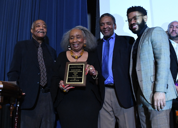 DC Black History Celebration Committee Director Chuck Hicks (left) presents the Black History Community Service Award to Sandra Butler Truesdale (right) with African American Civil War Museum founder Frank Smith and Aaron Holmes present at the event held at the museum in Northwest on Feb. 1. (Roy Lewis/The Washington Informer)