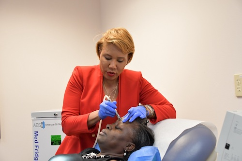 Vikisha Fripp, a plastic and reconstructive surgeon, conducts a microdermabrasion procedure on Leslie Smalls at the University of Maryland Capital Region Health office in Bowie on Jan. 31. (Anthony Tilghman/The Washington Informer)
