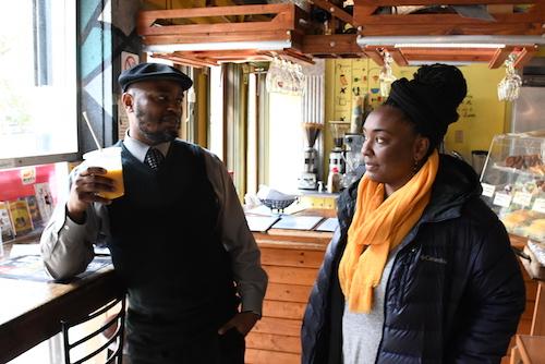 Ward 8 Advisory Neighborhood Commissioner Salim Adofo (left) discusses community issues with Krish Love at Sankofa Café on Feb. 1. (Roy Lewis/The Washington Informer)