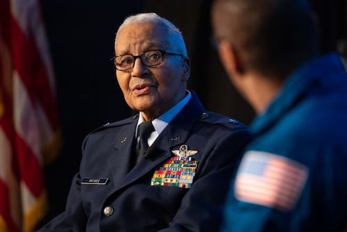 """Retired Air Force honorary Brig. Gen. Charles McGee speaks with NASA astronaut Alvin Drew at NASA's D.C. headquarters during a Black History Month program, """"Trailblazers: The Story of a Tuskegee Airman,"""" on Feb. 5. (Joel Kowsky/NASA)"""