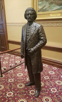 A life-size statue of Frederick Douglass inside the Maryland State House in Annapolis (William J. Ford/The Washington Informer)